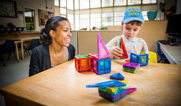 Child Care Education Program's teacher, left, interacts with a student as they play with building blocks inside the North Drive location on Thursday, April 21 2016. The Child Care Education Program is a part of the Department of Human Development and Family Studies within the School of Health and Human Sciences. (Tigermoth Creative/Chris English)